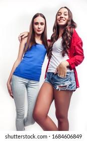 best friends teenage girls together having fun, posing emotional on white background, besties happy smiling, lifestyle people concept closeup. making selfie