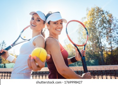 Best Friends of the tennis court with balls and rackets