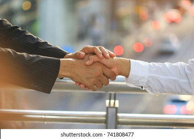 Best Friends, Two man holding their hands on bokeh and sunlight background, Take care concept