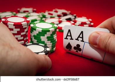 Best gamble in poker or lucky hand concept with player going all in with pocket aces (two aces) considered the best hand in poker preflop (before the flop is revealed)