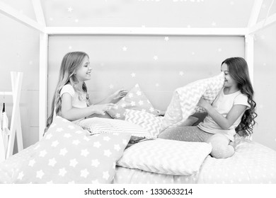Best girls sleepover party ideas. Girls happy best friends in pajamas with pillows sleepover party. Soulmates girls having fun sleepover party. Pillow fight pajama party. Sleepover time for fun.