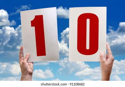 Best grades, excellent marks. White paper with numbers one and zero in male hands on blue sky background