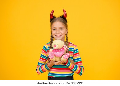 Best Halloween gift. Halloween child hold toy gift yellow background. Love you teddy bear gift. Gift shop for kids. Getting in spooky spirit.