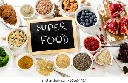 Best healthy Superfoods on  white wooden background. Flat lay