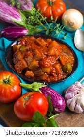 Best italian food - sicilian caponata with eggplants, tomatoes, onion, garlic and herbs, healthy vegetarian food