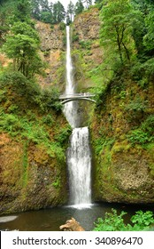 The best known of the waterfalls along the Columbia River Gorge. The upper and lower sections of the falls and the Benson Bridge are seen in this view.
