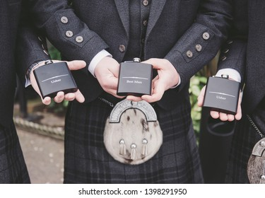 Best Man and Ushers hold hip flasks on wedding day