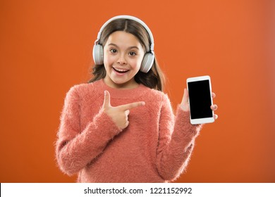 Best music apps that deserve a listen. Girl child listen music modern headphones and smartphone. Listen for free. Get music family subscription. Access to millions of songs. Enjoy music concept.