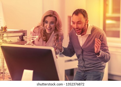 Best news. Two brilliant employees finding out about their promotion.