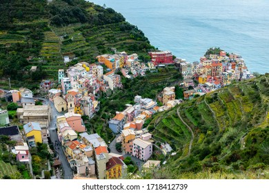 The best panorama of Italy. Manarolla. Ligurian coast. Cinque Terre National Park. Stone path to the sea. Medieval town on a rock by the sea.