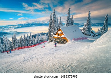 The best popular winter ski resort with skiers in Romania. Amazing touristic and winter holiday destination. Winter sunny day in Poiana Brasov ski resort, Transylvania, Romania, Europe