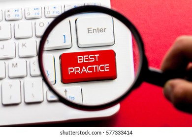 BEST PRACTICE word written on keyboard view with magnifier glass