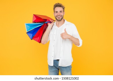 Best price. Cyber monday. Total sale. Positive man enjoying shopping. Happy man with shopping bags. Excited smiling guy doing shopping. Shopping happiness. Nice purchase. Gifts for holidays.