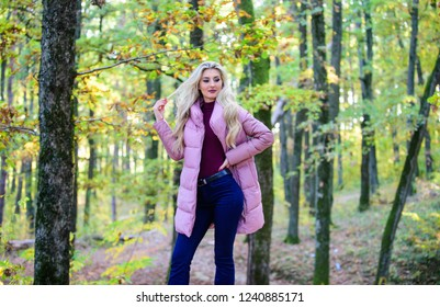 Best puffer coats to buy. How to rock puffer jacket like a star. Puffer fashion concept. Girl fashionable blonde walk in autumn forest. Woman wear warm pink jacket. Jackets everyone should have.