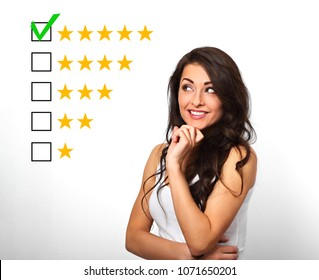 The best rating, evaluation, online rewiew. Business confident happy woman voting to five yellow star to increase ranking isolated on white background