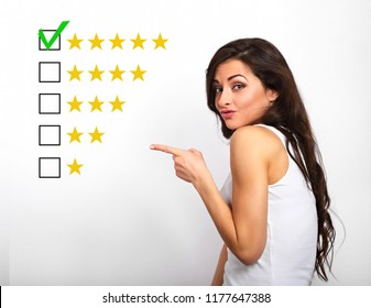The best rating, evaluation, online rewiew. Business confident happy woman voting to five yellow star showing the finger to increase ranking on white background