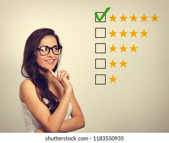 The best rating, evaluation, online rewiew. Business confident happy woman voting to five yellow star showing the finger to increase ranking. Vintage toned color