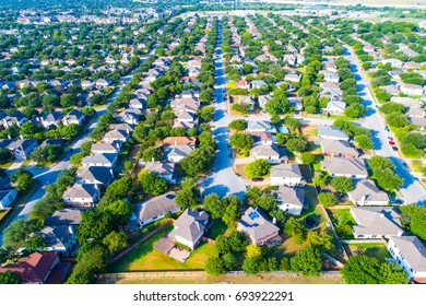 The best spots to live in Austin Texas aerial drone view near wells branch residential neighborhood above suburb suburbia homes forever