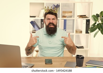 I am the best. Superiority and self confidence. King of office. Serious boss at work place. Aggressive boss shouting at you. Respect me. Man arrogant rude boss with golden crown sit in office.