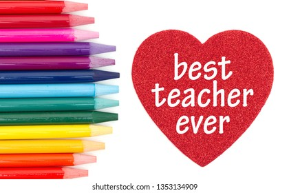 Best teacher ever message on red heart with colored watercolor pencils isolated over white