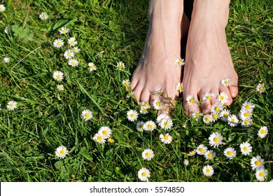 The best things in life are the simple things - womans feet on grass with wildflowers