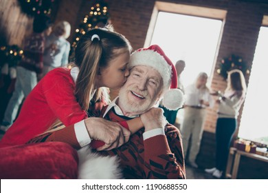 Best tradition happiness fairy december 2019 concept. Close up photo portrait of small little cute lovely dreamy charming girl kissing in cheer her kind bearded granddad decorated room christmastime