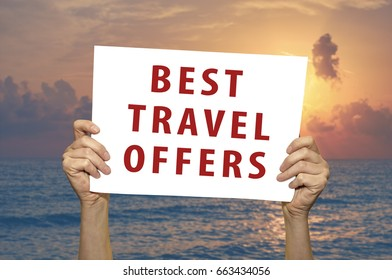 Best Travel Offers card in hand with a sea on background