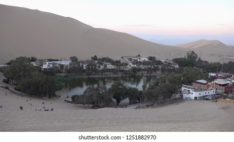 Best views in Huacachina Desert Oasis , peru , is built around a small natural lake in the desert.