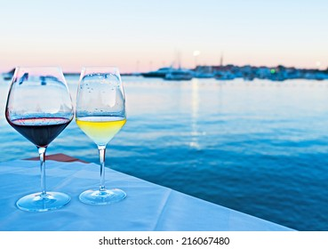 The best way to get enjoy from the sunset on Montenegro resort is to drink some wine with the view on the old town and port, Budva.