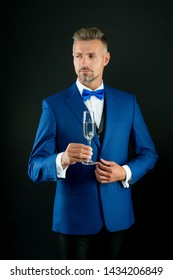 Best wishes. Champagne cheers. Man in suit corporate party. Boss director top manager hold glass champagne. Business celebration. Businessman drink sparkling wine. Celebrate success. Champagne toast.