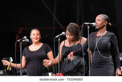 Bestival - 8th September, 2017: Three female  backing vocalists with British band Soul ll Soul performing at  Bestival festival , Lulworth, Dorset 8 September 2017, UK