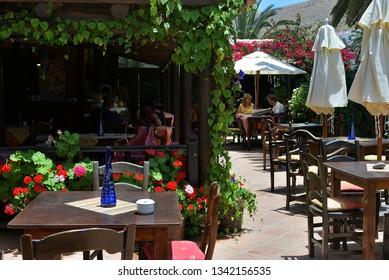 Betancuria. Fuerteventura, Spain - June 20, 2008: People visit street cafe in small town of Betancuria, popular tourist destination on the Fuerteventura island. Canary islands