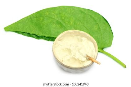 Betel leaf with a vintage pot of lime