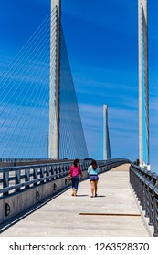 Bethany Beach, DE, USA - April 15,2015:  Pedestrians use the walkway on the Delaware Indian River Inlet Bridge.