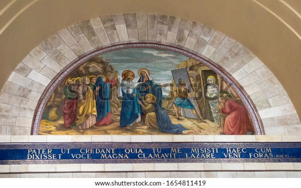 Bethany, Betania, Israel January 31, 2020: Church in Bethany in commemorating the home of Mari, Martha and Lazarus, Jesus' friends as well as the tomb of Lazarus. Israel. Colorful mosaic in the church