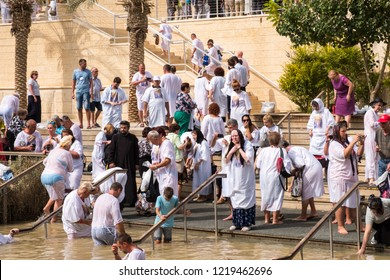 Bethany / Jordan - October 15 2018: Pilgrims baptizing in the Jordan River, in the Bethany Baptism Site.