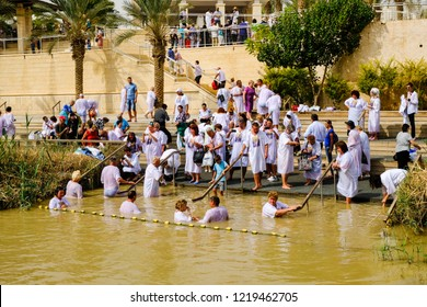 Bethany / Jordan - October 15 2018: Pilgrims baptizing in the Jordan River, in the Bethany Baptism Site.