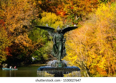 The Bethesda Fountain located at Bethesda Terrace in Central Park in the Autumn with red and yellow leaves changing color at the peak of the fall foliage season. Manhattan, New York, November 8, 2015