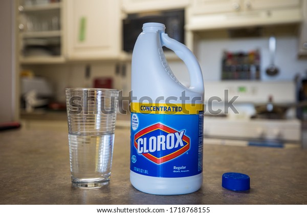 Bethesda, Maryland / USA - April 29, 2020: A person pours concentrated Clorox bleach into a glass. As with other bleach products, Clorox is a highly dangerous substance when ingested.