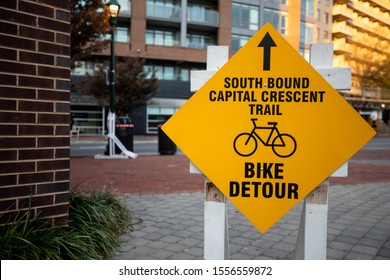 Bethesda, Maryland / USA - Nov. 10, 2019: A sign reroutes cycles along the Capital Crescent Trail. Construction is occurring for the Purple Line Metro.