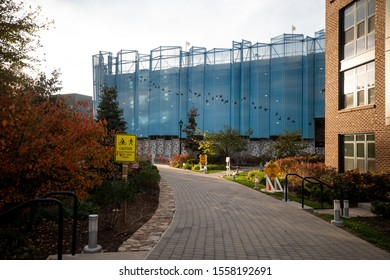 Bethesda, Maryland / USA - Nov. 10, 2019: A cobblestone path leads into the Capital Crescent Trail, a popular bike trail that is under construction due to the upcoming Purple Line Metro station.