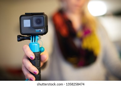 Bethesda, MD - April 1, 2019: A person holds a GoPro Hero6 Black, a small action camera that can be used in a variety of circumstances, including under water.