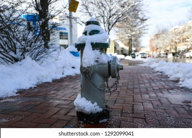 Bethesda, MD - January 15, 2019: A fire hydrant on Bethesda Row is covered in snow after Winter Storm Gia blankets the neighborhood in snow, forcing businesses, schools and workplaces to close down.