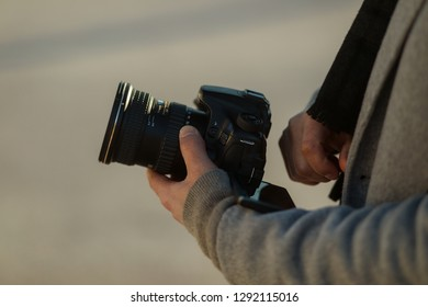 Bethesda, MD - January 15, 2019: A man holds a Canon 70D crop sensor camera with an 11-16mm Tamron wide angle lens on it.