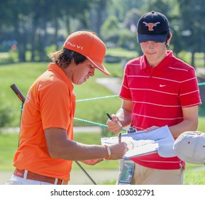 BETHESDA, MD - JUNE 13: Rickie Fowler signs an autograph for fans at Congressional during the 2011 US Open on June 13, 2011 in Bethesda, MD.