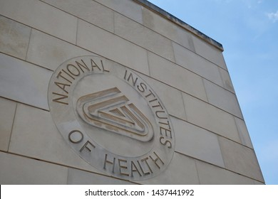 BETHESDA, MD - JUNE 29, 2019: NIH NATIONAL INSTITUTES OF HEALTH sign emblem seal on gateway center entrance building at NIH campus