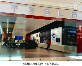 BETHESDA, MD - JUNE 29, 2019: TESLA - sign at mall retail entrance