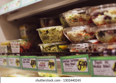 Bethesda, MD / USA - February 2, 2019: An assortment of pre made salads for sale at Trader Joe's grocery store chain on Wisconsin Avenue.