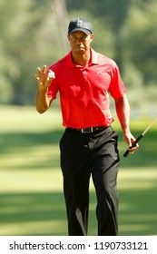 BETHESDA, MD-JUL 1: Tiger Woods waves to the crowd after putting on the 12th green during the final round of the AT&T National at Congressional Country Club.