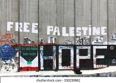 BETHLEHEM, ISRAEL, 2 APRIL 2013. Editorial photograph of Free Palestine Hope graffiti on Israeli Separation Wall